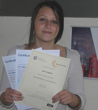 Zoe Longhorn with her NVQ certificates in customer service